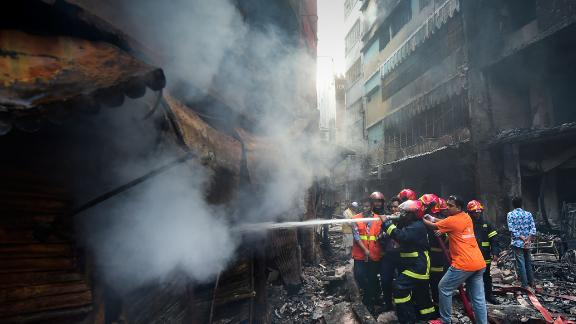 Firefighters try to extinguish a fire in Dhaka on February 21, 2019.