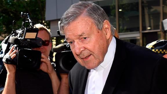 Cardinal George Pell walks to a car in Melbourne on December 11.