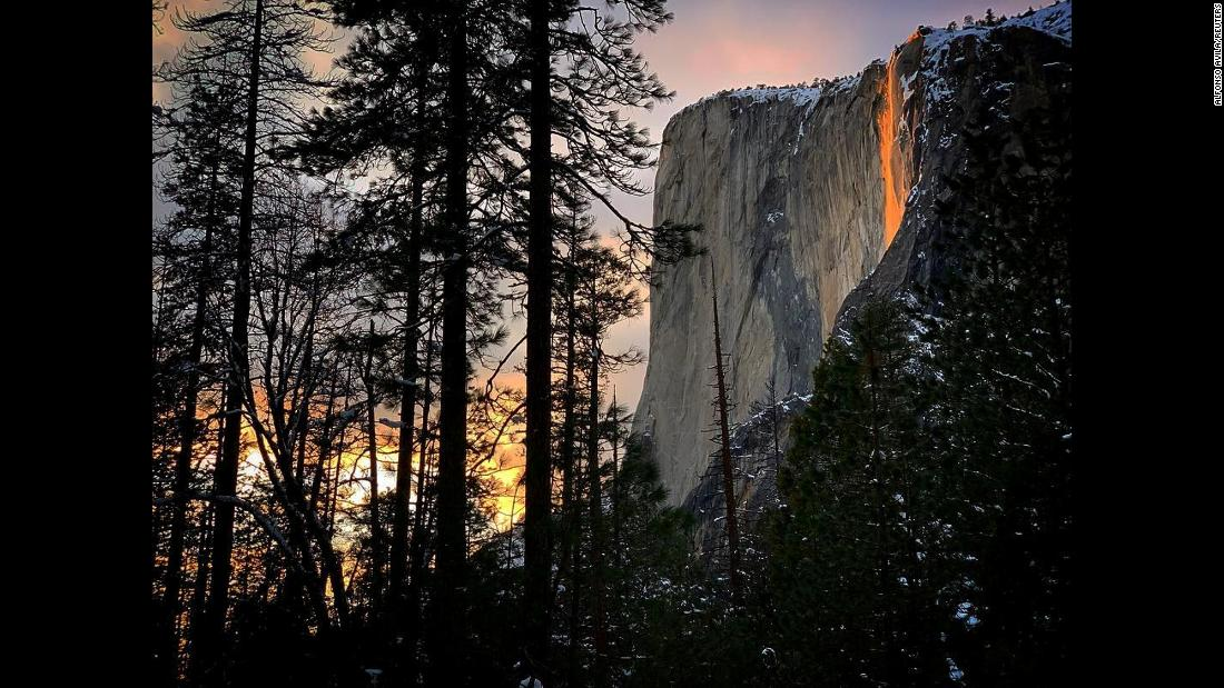 Sunlight hits the Horsetail Fall at California's Yosemite National Park on Tuesday, February 19. The light makes it look as though lava is flowing over the cliff instead of water.