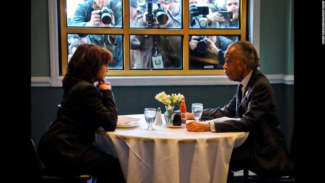 Media members photograph US Sen. Kamala Harris, a Democratic presidential candidate, and the Rev. Al Sharpton as they have lunch at Sylvia's Restaurant in New York on Thursday, February 21. See all the Democrats who are running for president