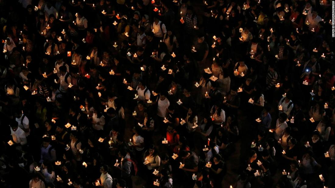 College students in Kolkata, India, hold candles Tuesday, February 19, during a vigil for paramilitary personnel who were killed when a bomb exploded near their convoy in Indian-administered Kashmir.