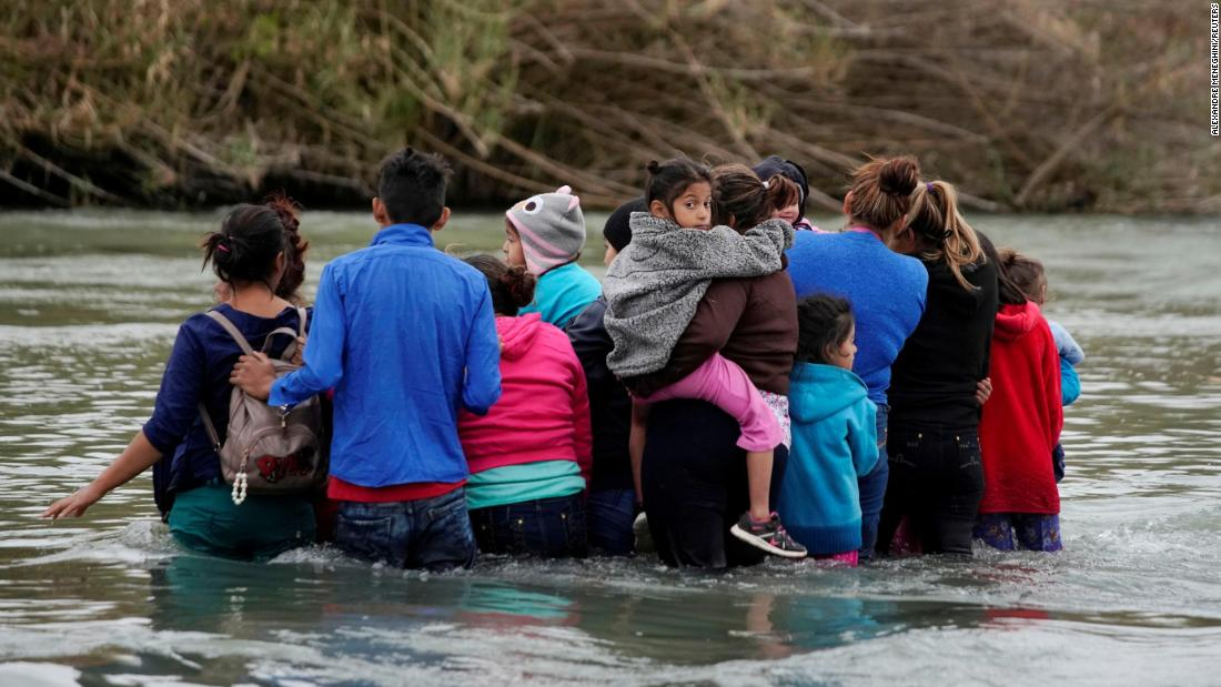 Migrants in Piedras Negras, Mexico, cross the Rio Bravo on their way to the United States on Tuesday, February 19. It was four days after US President Donald Trump declared a national emergency on the southern border.