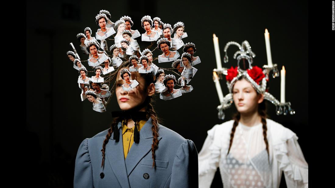 A model presents a creation adorned with images of Britain's Queen Elizabeth II during a Pushbutton catwalk show in London on Tuesday, February 19.