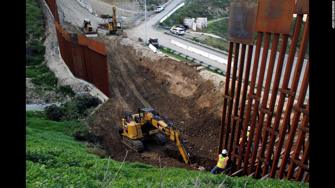 Construction crews begin to replace some of the aging fencing on the border that separates San Diego from Tijuana, Mexico, on Monday, February 18. The replacement project had been in the works for some time and is not related to the recent controversy over new wall funding.