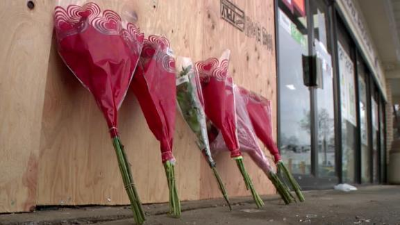 Flowers were laid outside the 7-Eleven where the incident occurred.