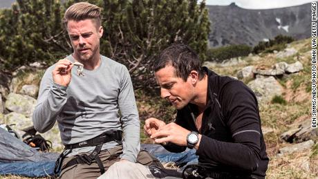 Bear Grylls, right, could face a fine from the Bulgarian government after killing a frog while filming in the Rila mountains with Derek Hough in 2017.