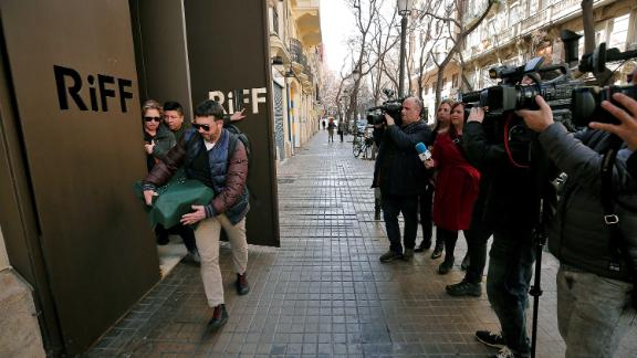 Two officials from the regional health authority (left) leave the restaurant on February 19