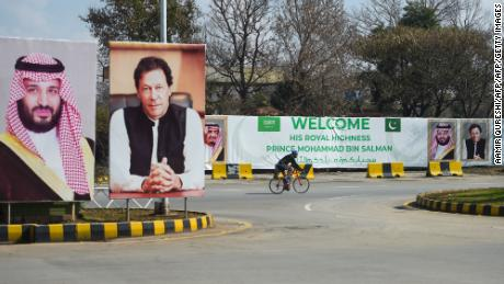 Billboards show  portraits of Saudi Arabian Crown Prince Mohammed bin Salman and Pakistan's Prime Minister Imran Khan ahead of his arrival in Islamabad on February 15, 2019.