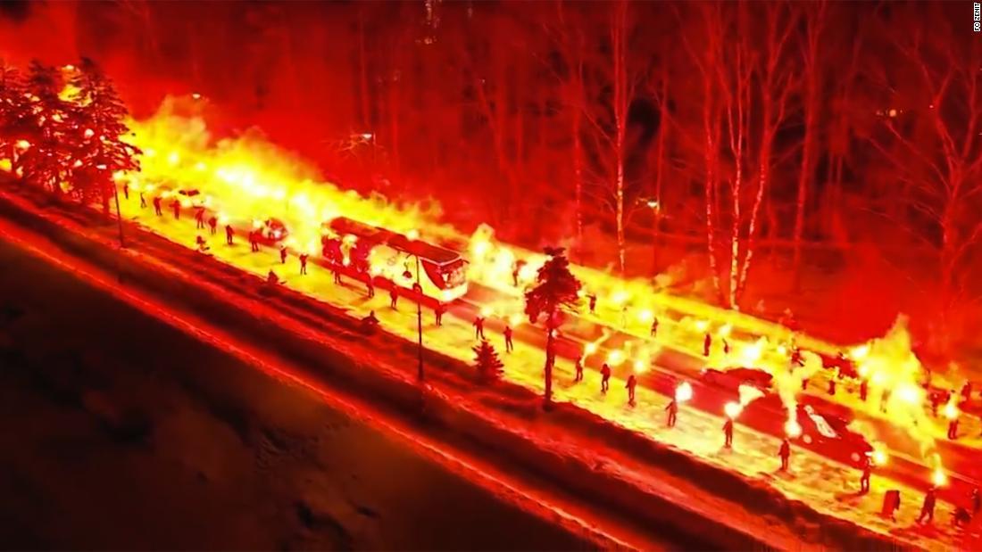 Russian soccer fans fiery guard of honor