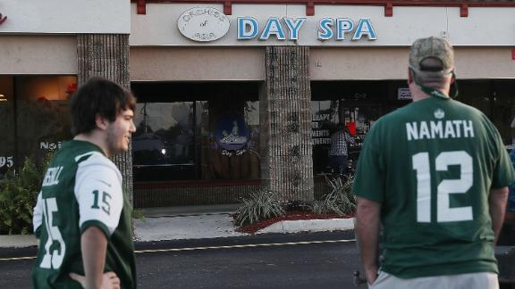Football fans arrive to the Orchids of Asia Day Spa in Jupiter, Florida on Friday.