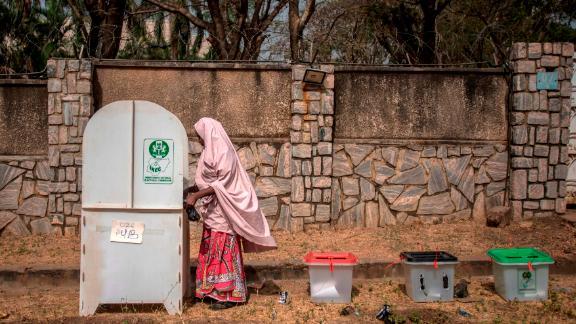 A woman casts her ballots at Unguwar Sarki polling station in Kaduna.