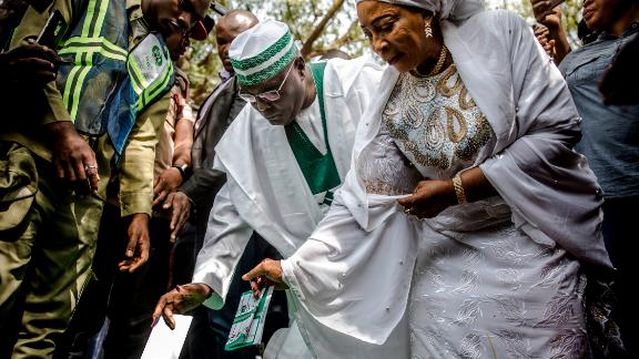 Presidential candidate and main opposition leader Atiku Abubakar casts his vote along with his wife, Amina Titilayo Atiku-Abubakar, at Agiya polling station in Yola.