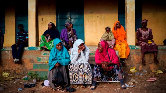 Nigerian voters wait for the scheduled opening of polling stations in Kaduna.