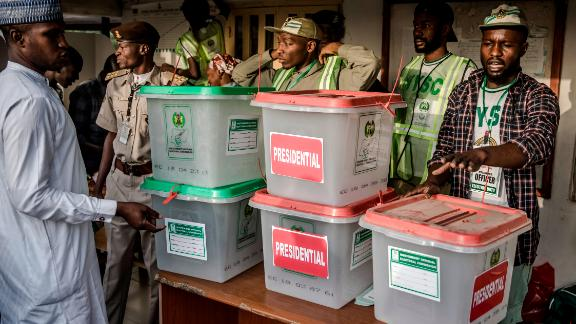 Electoral commission officers prepare ballot boxes before the Shagari Health Unit polling station opens in Yola.