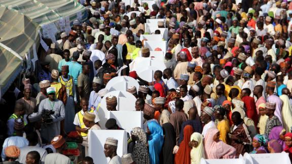Nigerians wait to vote in Maiduguri.