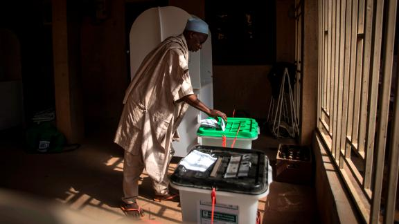 One of the first voters casts his ballots for presidential and parliamentary seats on Saturday, February 23, at the Unguwar Sarki polling station in Kaduna, Nigeria.