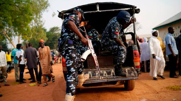 Nigerian police arrive at a polling station in Kaduna.