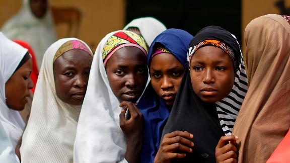Women line up to cast their votes in the village of Tumfafi, near Kano.