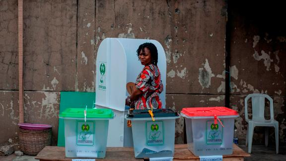 A woman glances over at the ballot boxes one last time before casting her vote Saturday in Lagos.