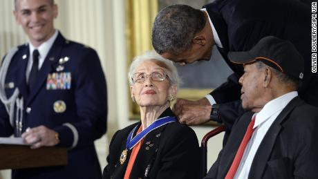 President Barack Obama gives the Presidential Medal of Freedom to Katherine Johnson in 2015.