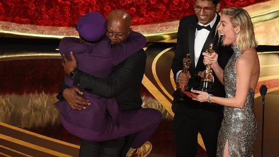 Spike Lee jumps in the arms of Actor Samuel L. Jackson as he accepts the award for best adapted screenplay