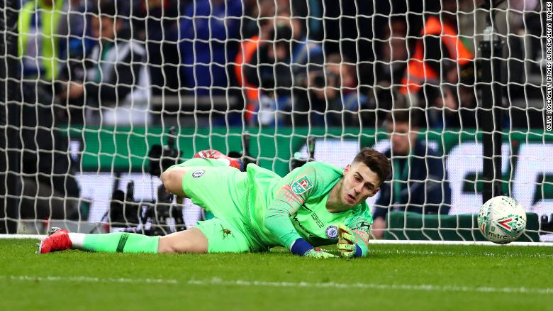Kepa allows Sergio Aguero's weak penalty to squirm under his hands.
