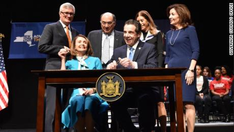 "New York Governor Andrew Cuomo, joined by House Speaker Nancy Pelosi, signed a new 'red flag"" gun protection bill into law Monday."