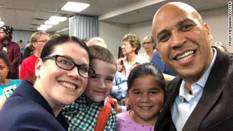 Iowa voter Meghann Foster with 2020 presidential candidate Cory Booker.