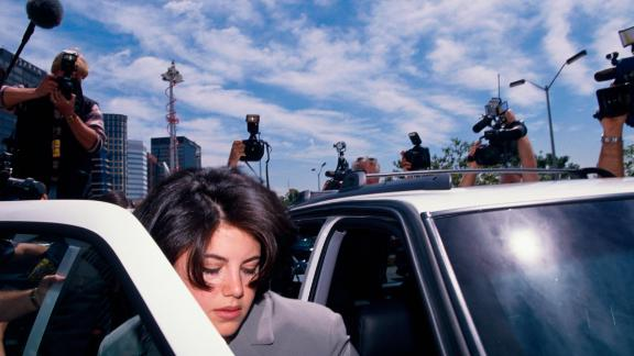 Monica Lewinsky surrounded by photographers as she gets into car. Lewinsky is on her way to the FBI Headquarters. (Photo by Jeffrey Markowitz/Sygma via Getty Images)
