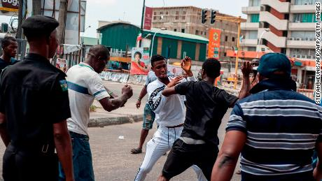 A fight breaks out over the alleged distribution of money for votes at a polling unit in Alagomeji-Yaba in Lagos on February 23, 2019 during the general elections.