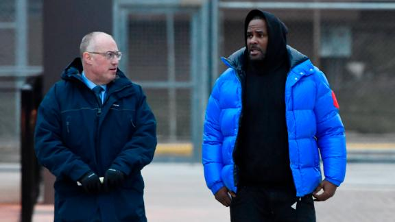 R. Kelly, right, leaves Cook County Jail with his attorney Steve Greenberg on Monday.