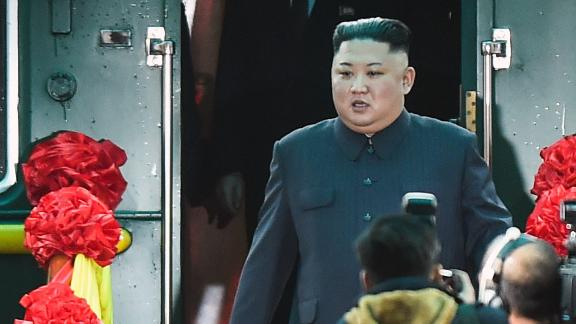 North Korea's leader Kim Jong Un (C) arrives at the Dong Dang railway station in Dong Dang, Lang Son province, on February 26, 2019, to attend the second US-North Korea. - North Korean leader Kim Jong Un crossed into Vietnam on February 26 after a marathon train journey for a second summit showdown with Donald Trump, with the world looking for concrete progress over the North's nuclear programme. (Photo by Nhac NGUYEN / AFP)        (Photo credit should read NHAC NGUYEN/AFP/Getty Images)