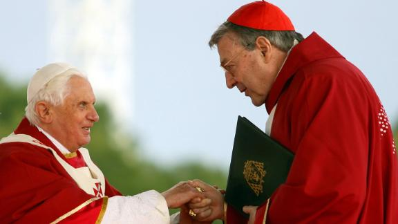 Pope Benedict XVI shakes hands with Cardinal George Pell during the Final Mass during World Youth Day Sydney 2008 in Sydney, Australia.
