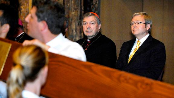 Australia's then-Prime Minister Kevin Rudd, right, and Cardinal Pell watch as the World Youth Day Cross and Icon enters the Great Hall of Parliament House in Canberra on February 18, 2008.