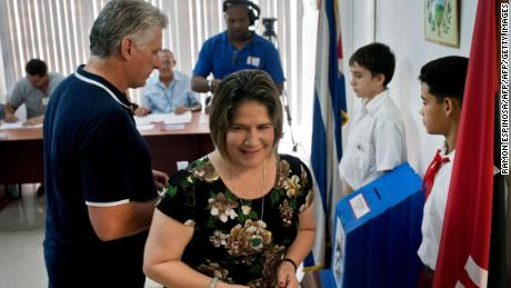 Cuban President Miguel Diaz-Canel and his wife, Lis Cuesta, vote in the referendum for the new Cuban constitution in Havana on February 24.