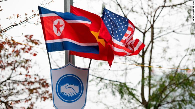 The flags of Vietnam, the United States and North Korea on display Sunday near Hoan Kiem Lake in Hanoi on Sunday.