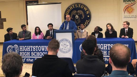 Teacher Stuart Wexler leads a student panel at Hightstown High School to discuss their work on the Cold Case Act.