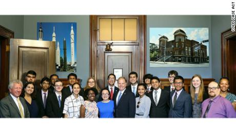 Students meet with Sen. Doug Jones, center, prior to his introduction of the Cold Case Act in the US Senate on July 10, 2018.