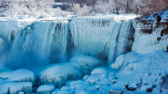An 'ice bridge' at the bottom of the falls forms when ice chunks pop up and out of the pool, creating a glacier 80-100 feet thick. (Tara Walton/The Canadian Press via AP)