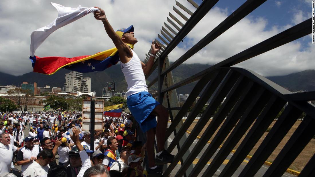 Guaido supporters take part in a march in Caracas on February 23. Venezuelan security forces fired tear gas and rubber bullets to disperse a crowd demanding to cross the Venezuela-Colombia border, which was ordered closed by Maduro.