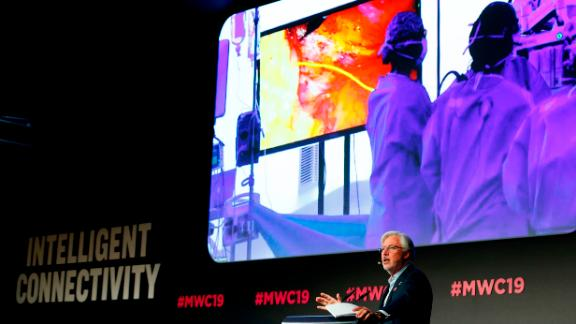 Doctor Antonio Lacy of Hospital Clinic de Barcelona delivers a speech about the first 5G tele-mentored live surgery at the Mobile World Congress (MWC) in Barcelona on February 27, 2019. - Phone makers will focus on foldable screens and the introduction of blazing fast 5G wireless networks at the world