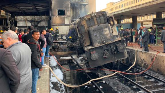 A destroyed train rests on tracks Wednesday after a fire at the main train station in Cairo.