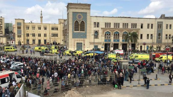Crowds gather outside the main train station (on background) in Cairo, Egypt.