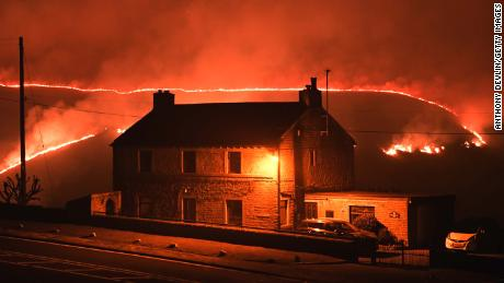 A wildfire burns on Tuesday, February 26, 2019, on Saddleworth Moor, near Marsden, England.