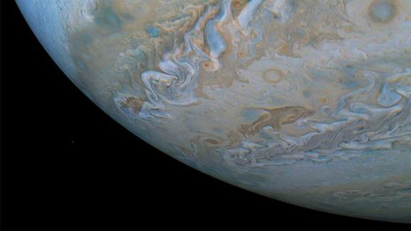 Is that a dolphin on Jupiter? No, but it definitely looks like one. It's actually a cloud that looks like it's swimming through cloud bands along the South Temperate Belt.