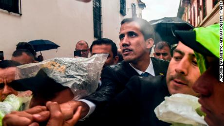 Venezualan opposition leader and self-declared acting president Juan Guaido (C) is greeted by people after holding a meeting with members of a multinational support group in the framework of the Lima Group to discuss a joint strategy to resolve Venezuela's crisis, at the Foreign Ministry in Bogota, on February 25, 2019.
