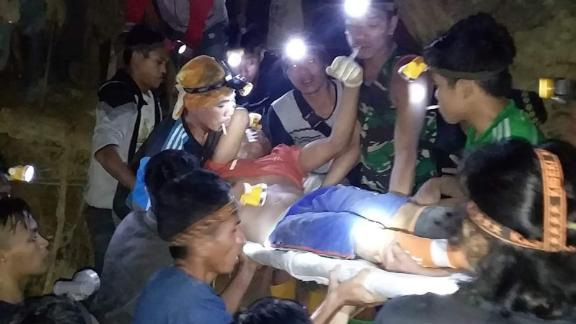 Rescuers work to bring miners out from a collapsed mine in North Sulawesi province, Indonesia.