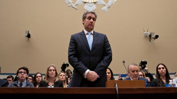 Michael Cohen, President Donald Trump's former personal lawyer, pauses just after being sworn in to testify before the House Oversight and Reform Committee on Capitol Hill in Washington, Wednesday, Feb. 27, 2019. (AP Photo/J. Scott Applewhite)