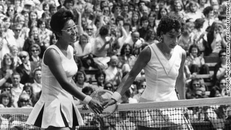 Heldman (right) meets Kazuko Sawamatsu at the net after facing the Japanese player at Wimbledon in 1974.