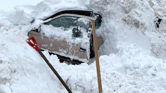 Snowplow hits buried vehicle, crew saves woman stuck inside